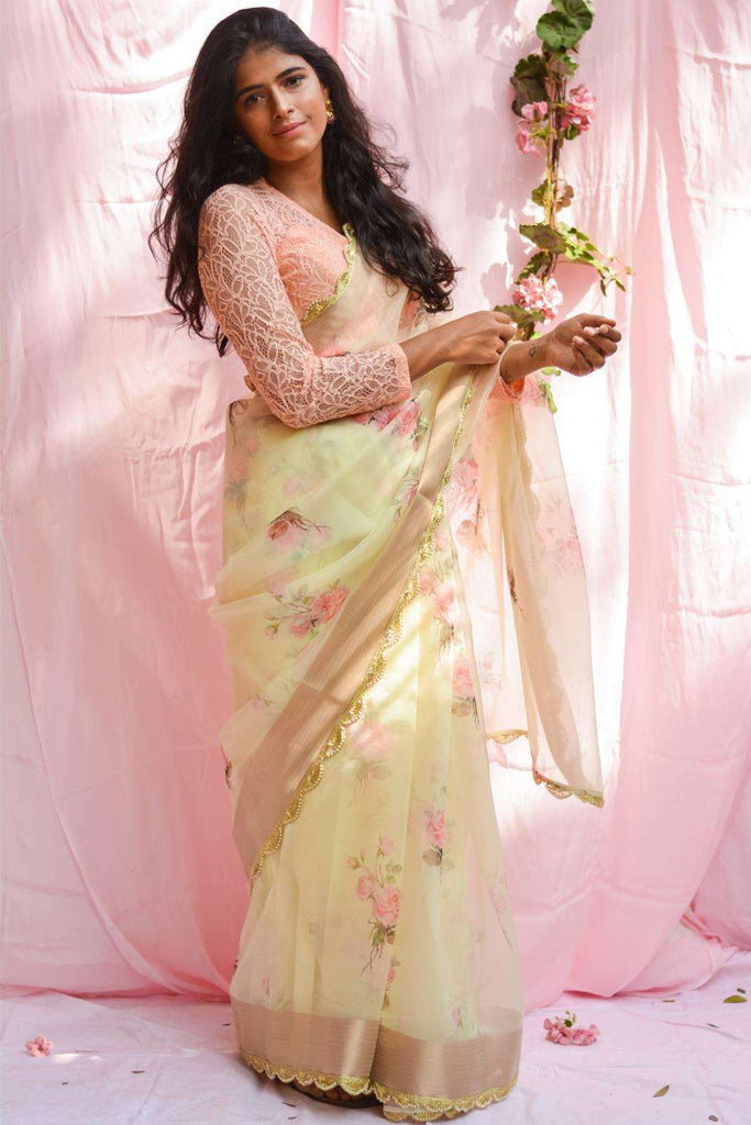 Lemon yellow floral printed organza saree with tissue border and scallop edging