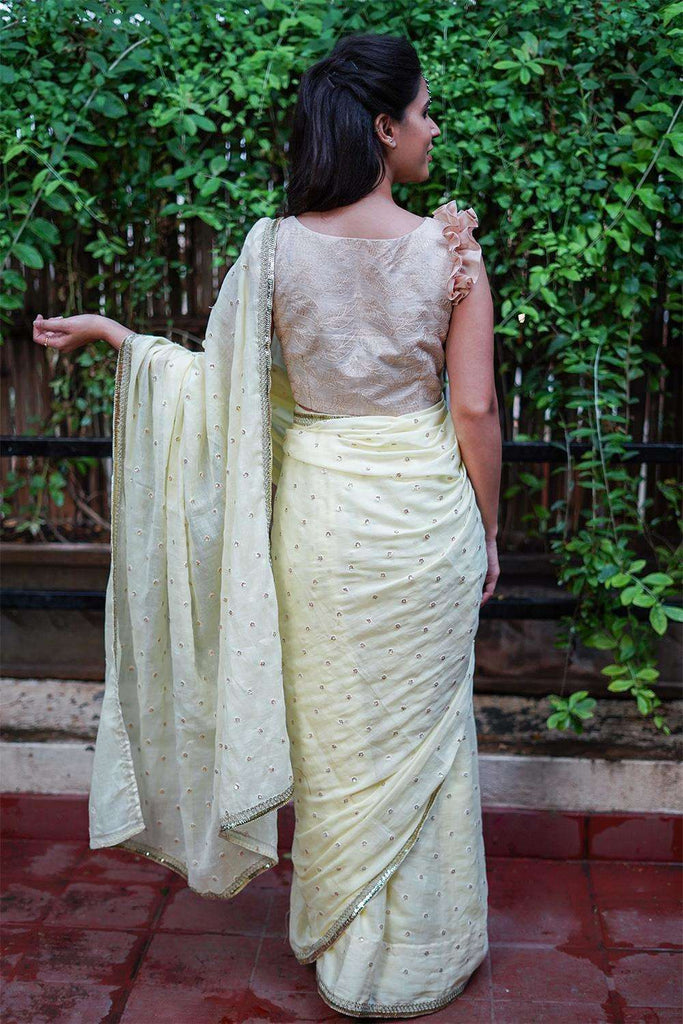 Light yellow mul cotton with gold sequin motifs and gold lace edging