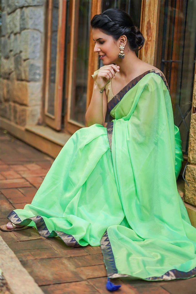 Lime green soft organza saree with Navy blue temple and zari brocade border