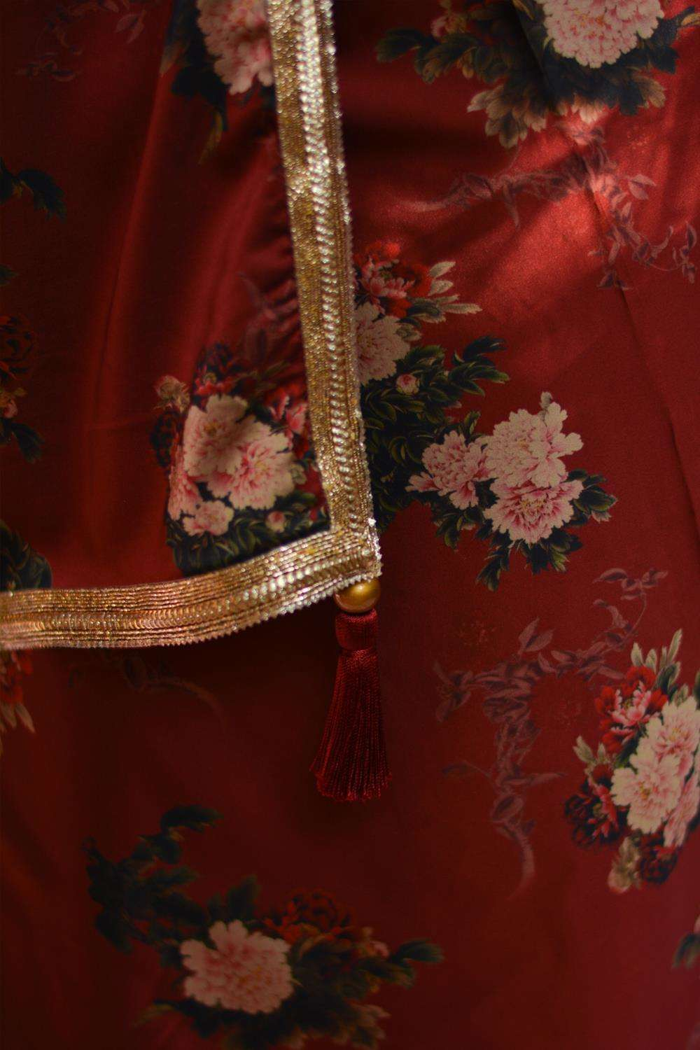 Maroon floral printed pure satin saree with gold shimmer border