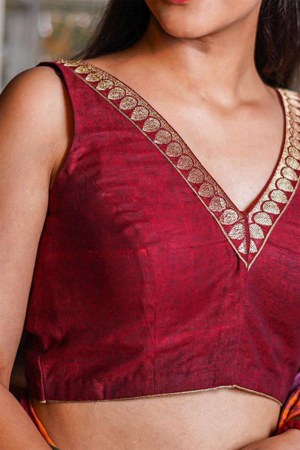 Maroon Khadi cotton V neck sleeveless blouse with maroon zari border
