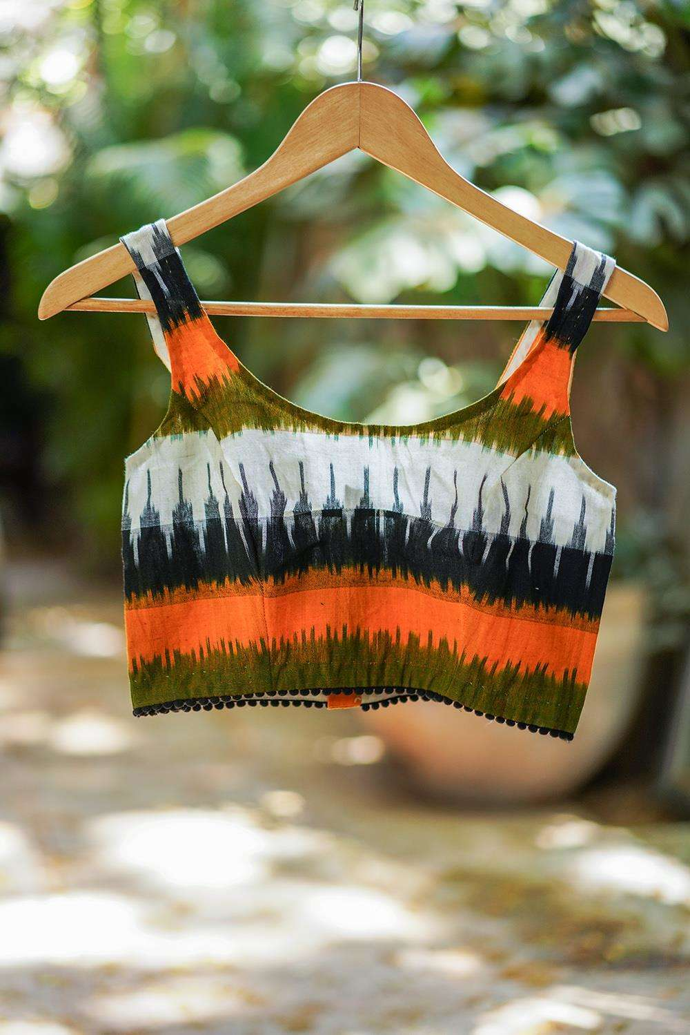 Mustard, green and black Ikat cotton sleeveless blouse with black pom pom edging