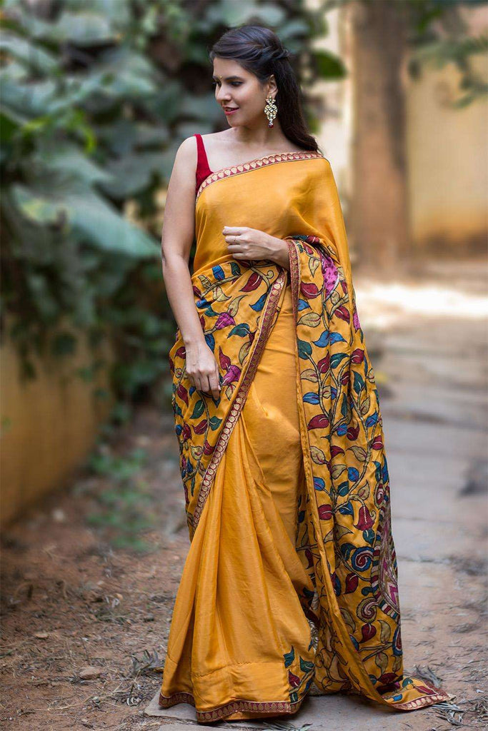 Mustard pure crepe saree with handpainted Kalamkari cross pallu appliqué