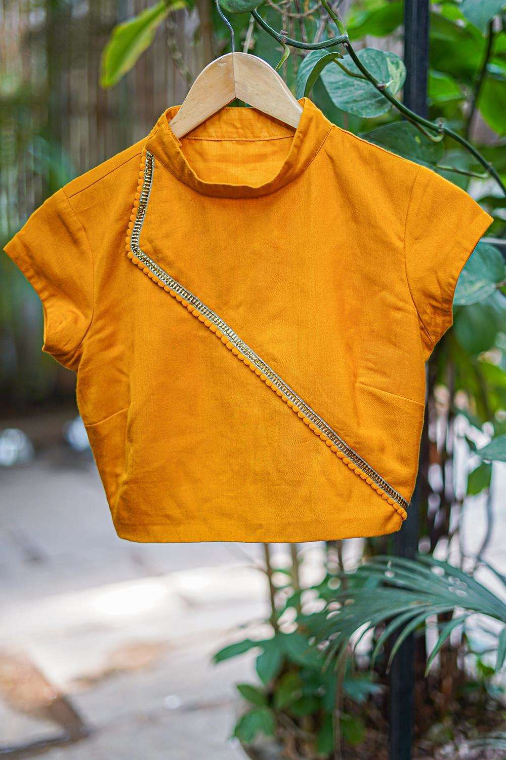 Mustard soft cotton hi neck blouse with gold lace and pom pom detailing - House of Blouse