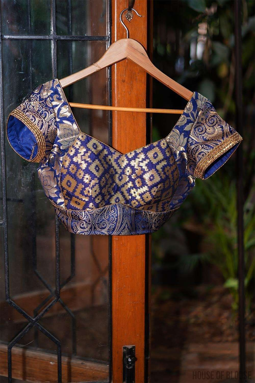 Navy blue and gold brocade three fabric sweetheart neck blouse