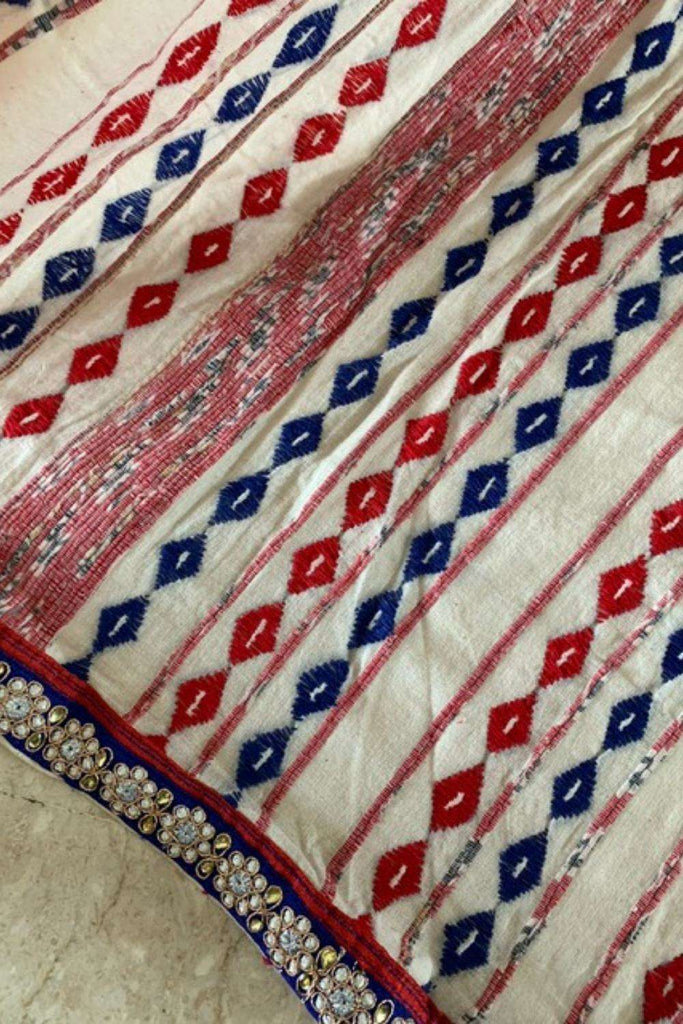 Off white Bengal cotton saree with red and blue threadwork and blue floral border - House of Blouse