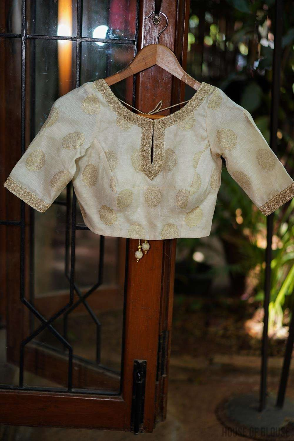 Off white chanderi brocade blouse with zari motifs and border detailing