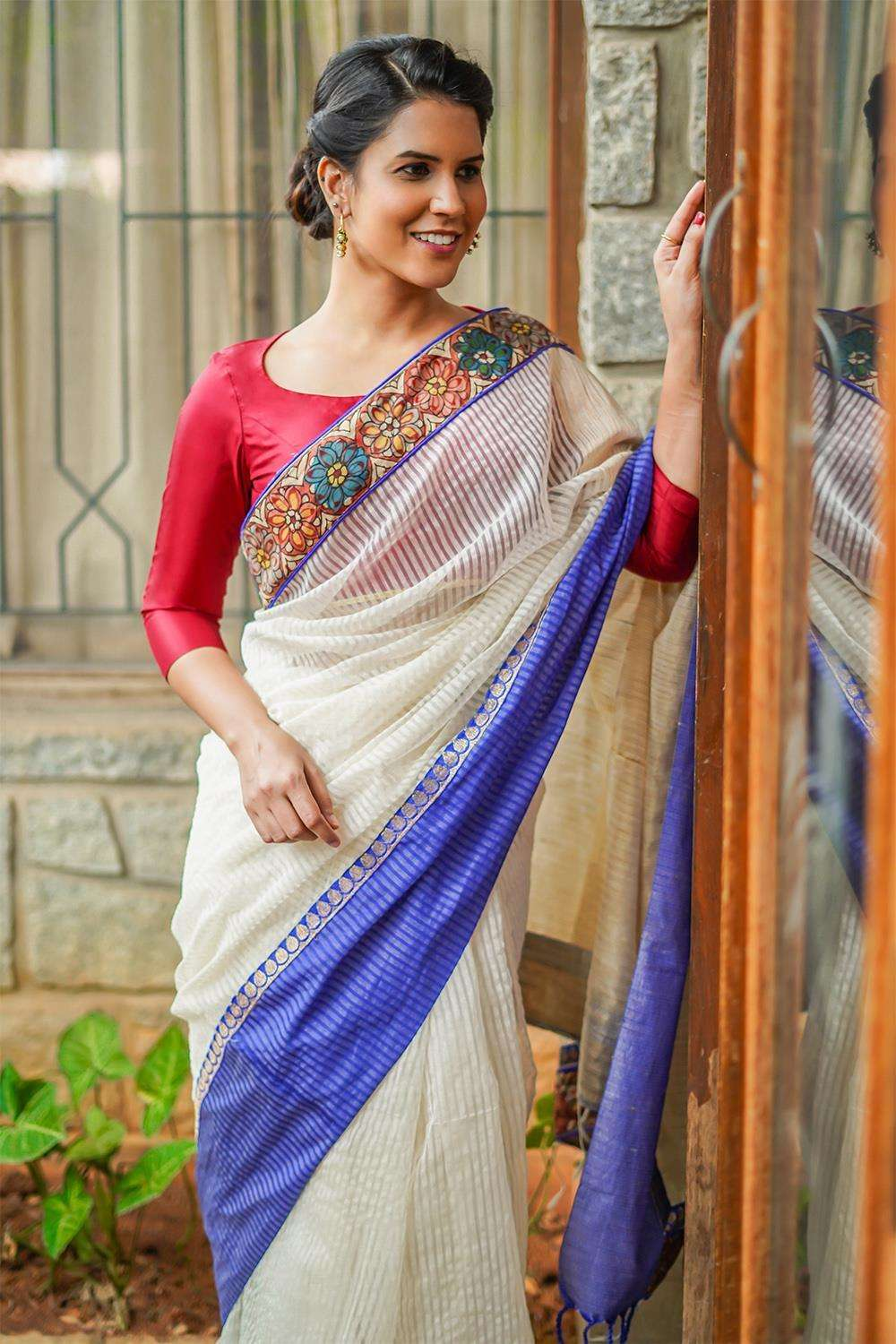 Off white striped silk cotton saree with handpainted kalamkari border and jute pallu