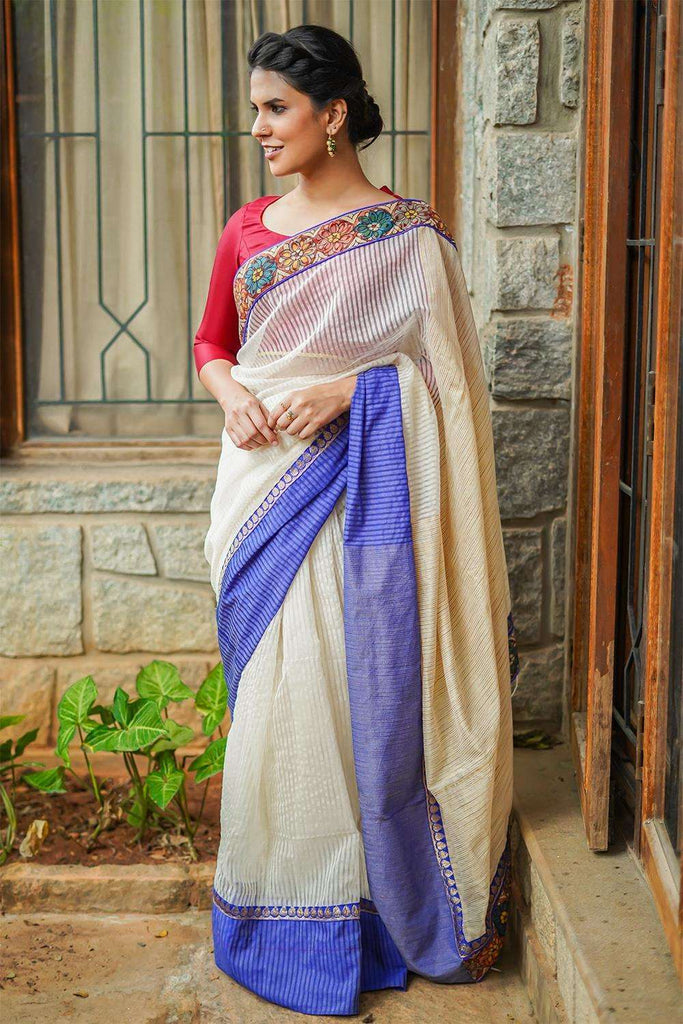 Off white striped silk cotton saree with handpainted kalamkari border and jute pallu - House of Blouse