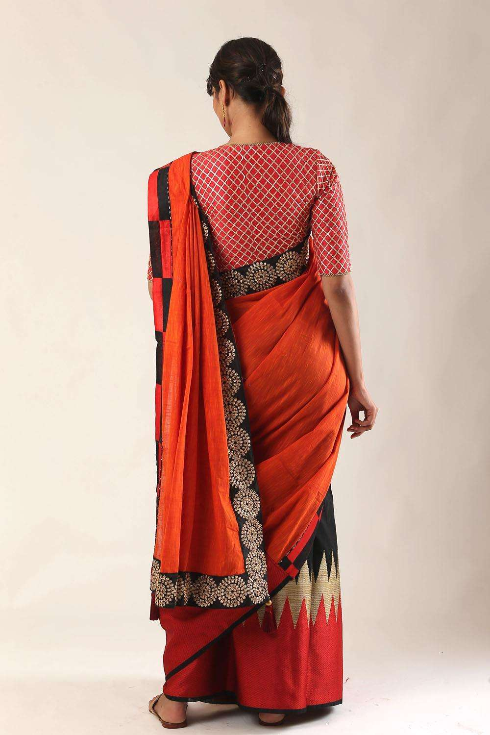 Orange and black cotton half and half saree with black embroidered border