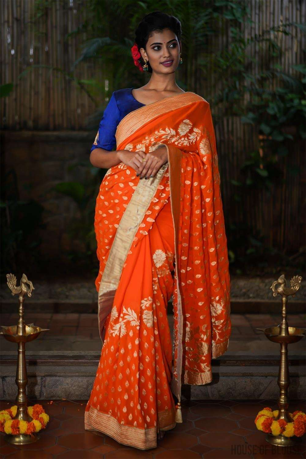 Orange Banarasi georgette saree with gold zari design and border