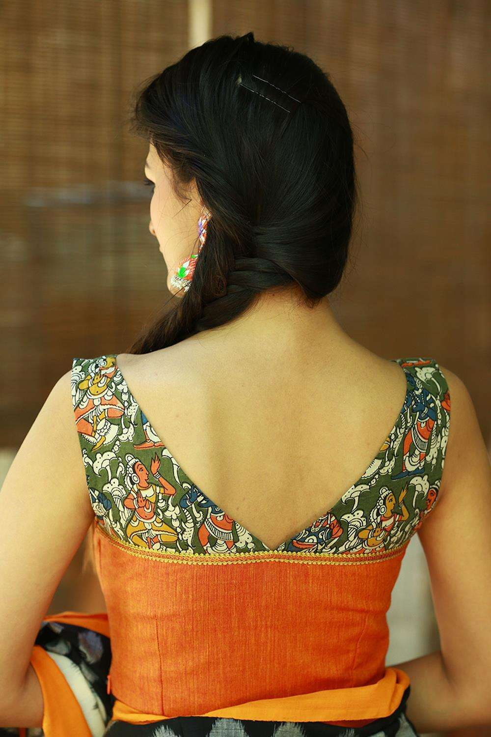 Orange khadi boatneck blouse with green kalamkari yoke - House of Blouse