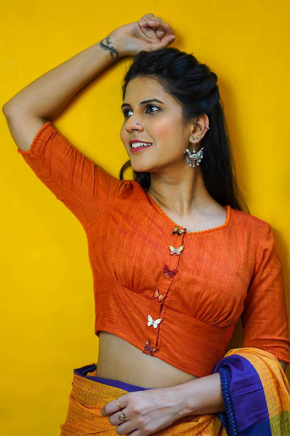 Orange khadi rounded V neck blouse with orange pom pom edging