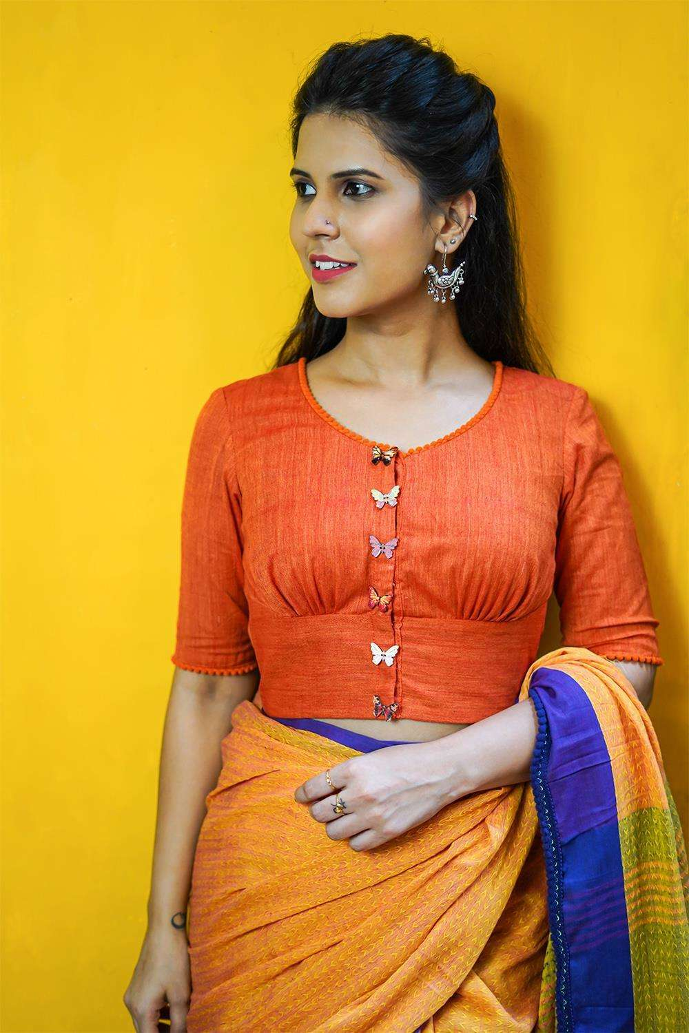 Orange khadi rounded V neck blouse with orange pom pom edging - House of Blouse