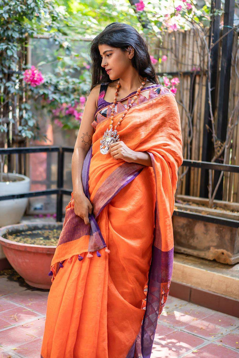 Orange linen saree with purple tissue and cutwork border + cutwork pallu