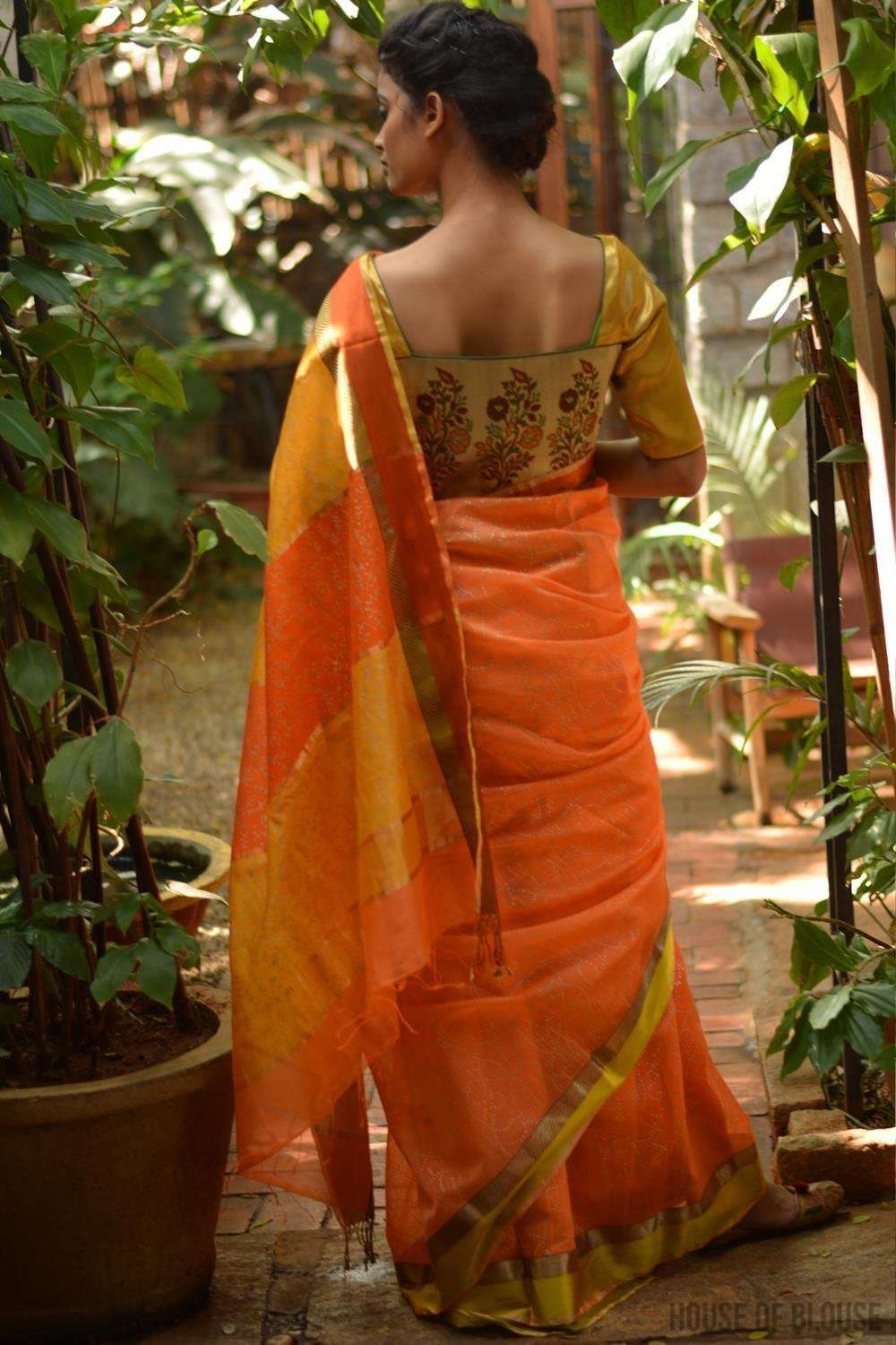 Orange Maheshwari silk saree with gold block print, zari and ganga jamuna border
