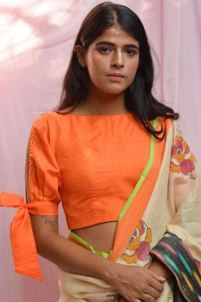 Orange raw silk boat neck blouse with tie up sleeves