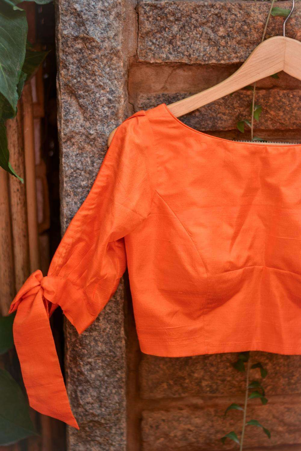 Orange raw silk boat neck blouse with tie up sleeves - House of Blouse