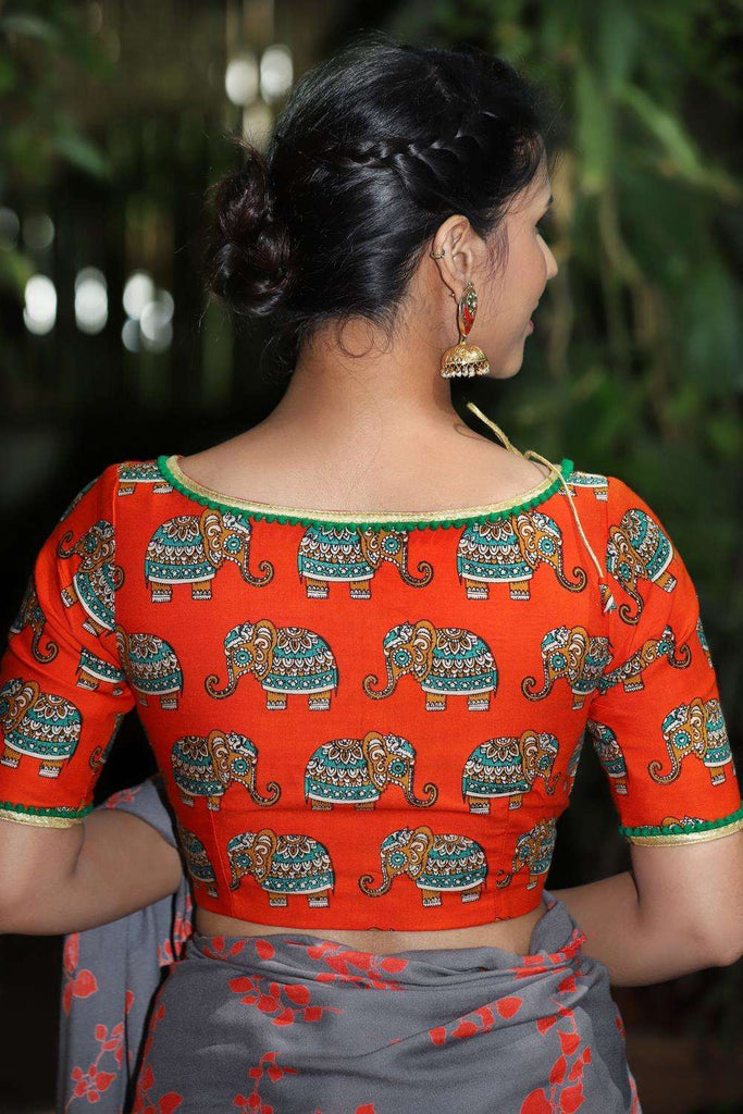 Orange rayon boatneck blouse with printed Kalamkari elephant motifs and border detailing - House of Blouse