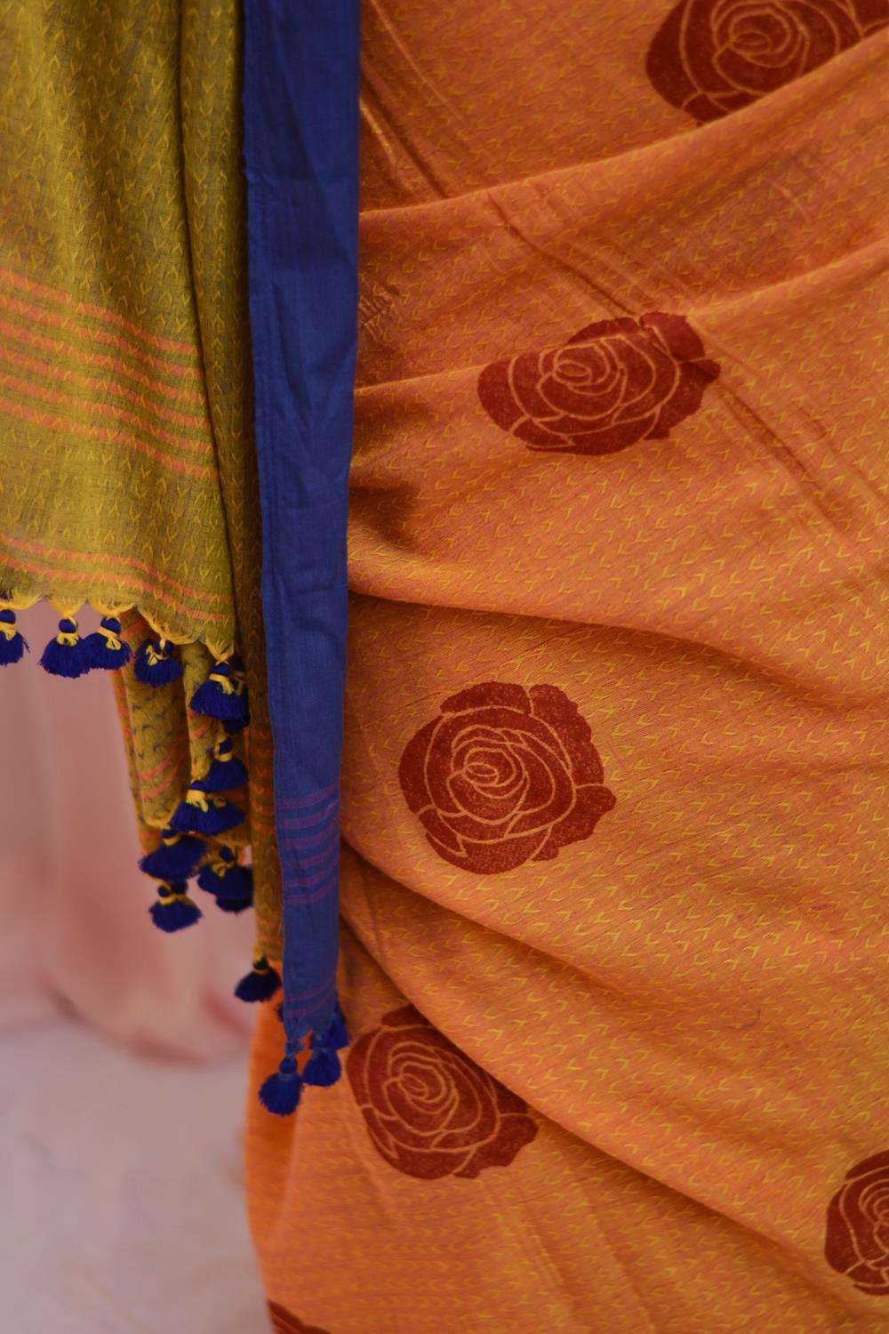 Orange self woven soft handloom cotton saree with red block print and violet border