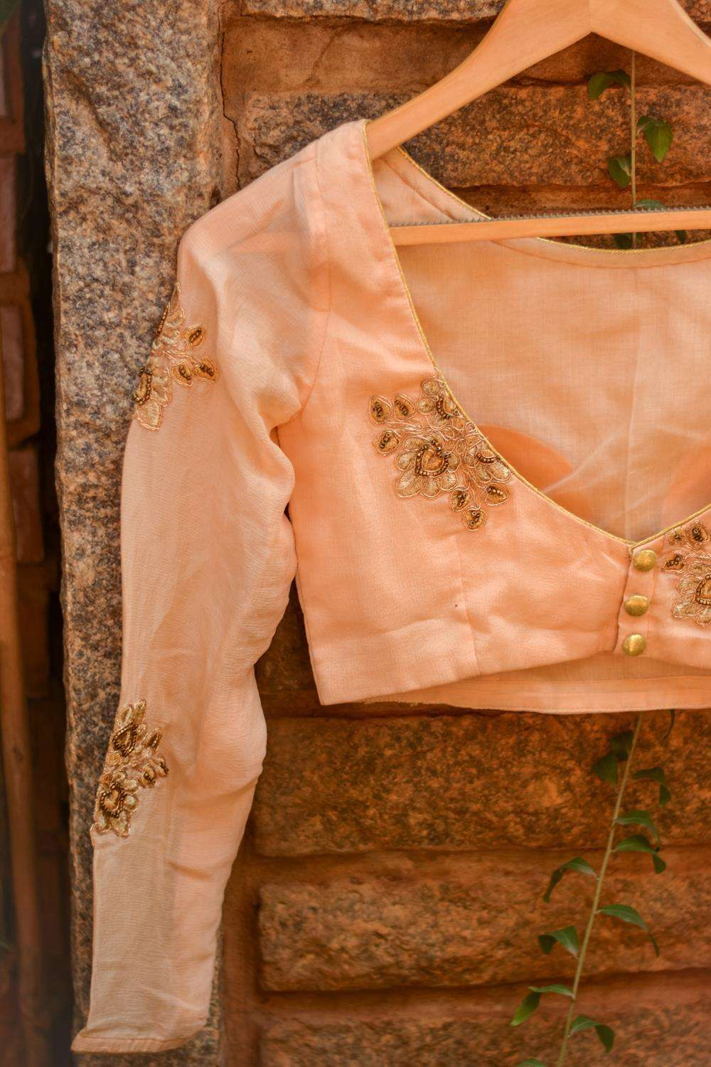 Pale orange embroidered chinon crepe boatneck blouse