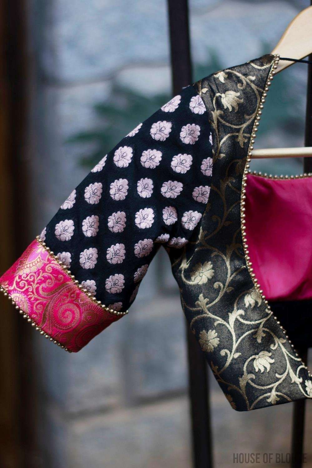 Patchwork blouse made in black and pink brocade with gold bead edging.