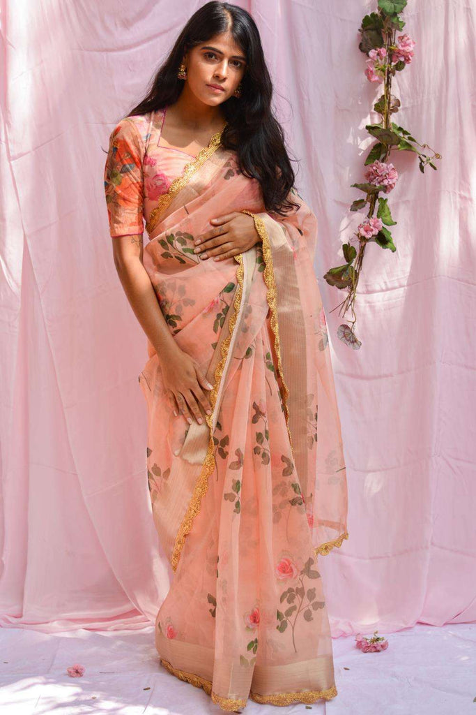 Peach floral printed organza saree with tissue border and scallop edging - House of Blouse