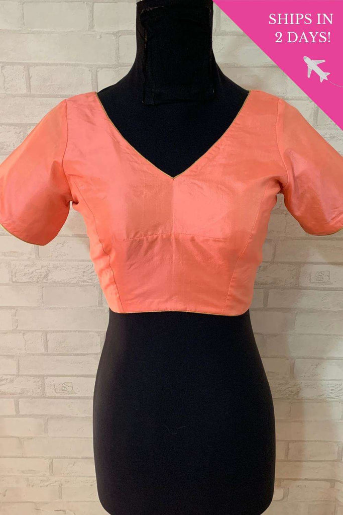 Peach plain silk V neck blouse with potli buttons; Size: 36