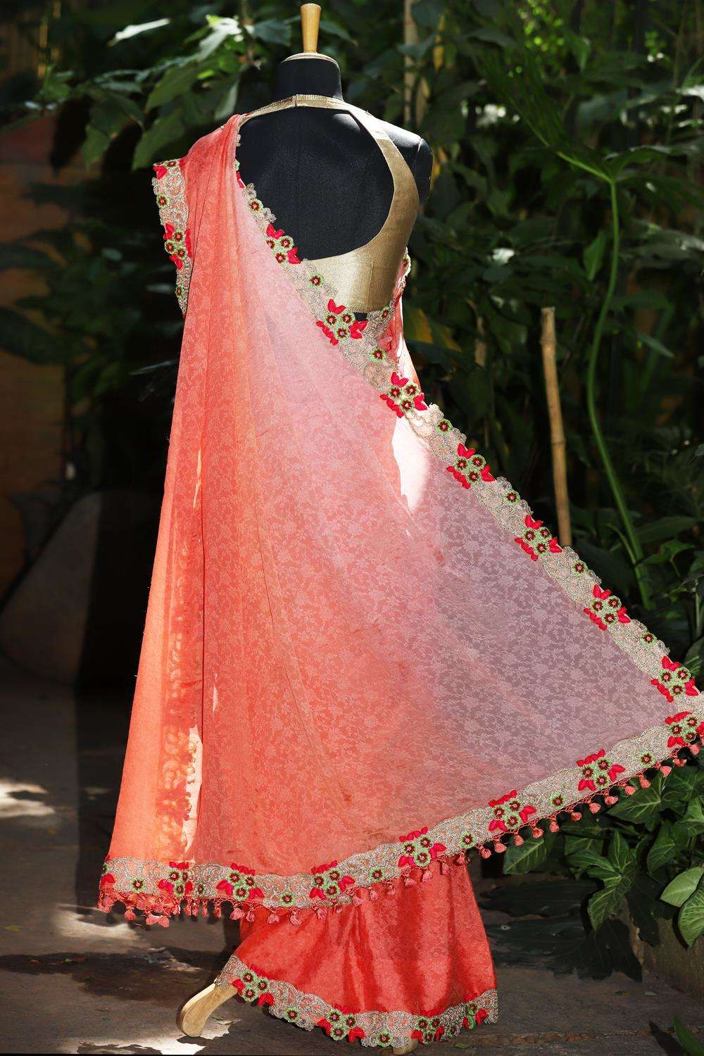 Peach shaded self embossed crepe saree with floral cutwork border