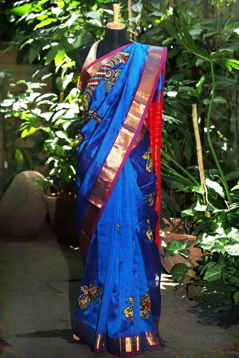 Peacock blue silk cotton saree with pink zari border and handpainted kalamkari appliques