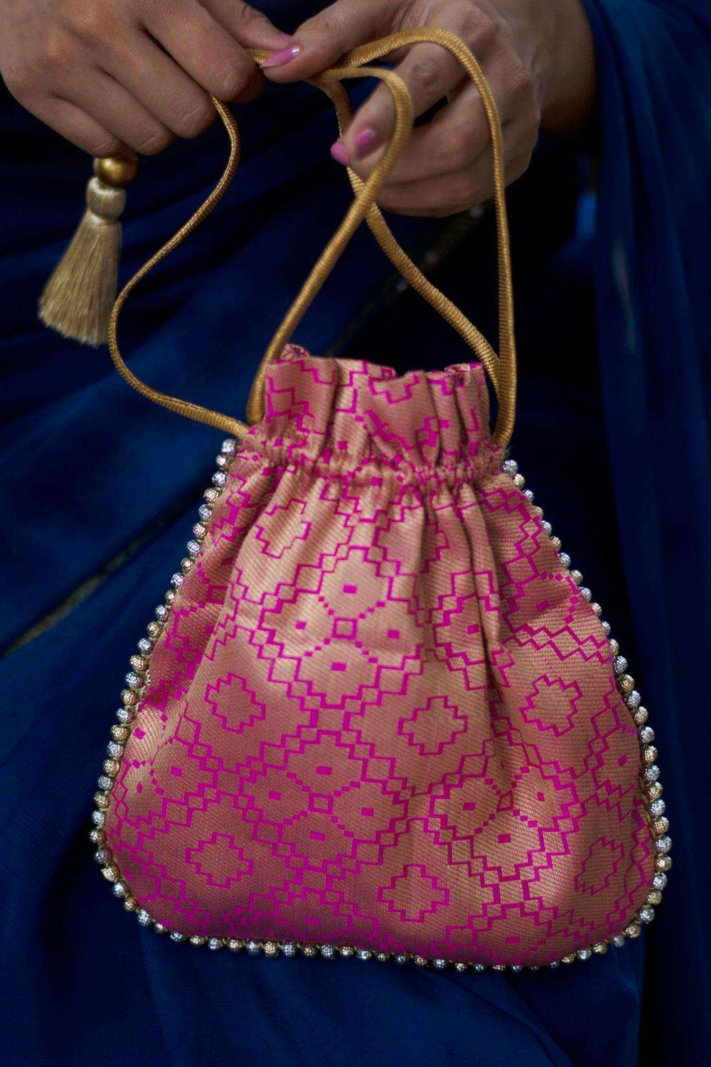 Pink and gold brocade Potli bag with silver and gold bead detailing