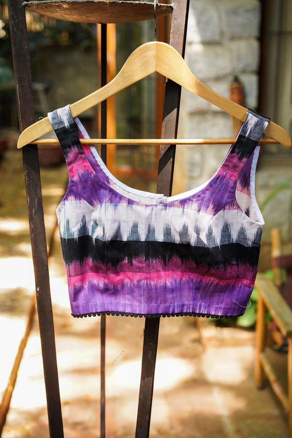 Pink, purple and black Ikat cotton sleeveless blouse with black pom pom edging