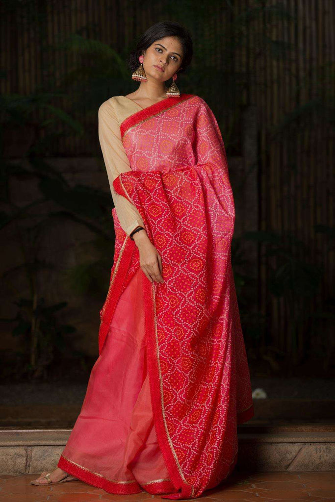 Pink to red shaded bandhani printed half and half saree with red lace border