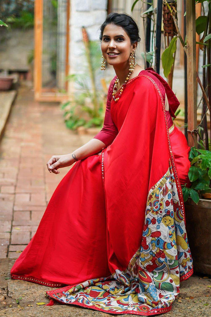 Pinkish red soft satin saree with red mirrorwork border and handpainted kalamkari pallu