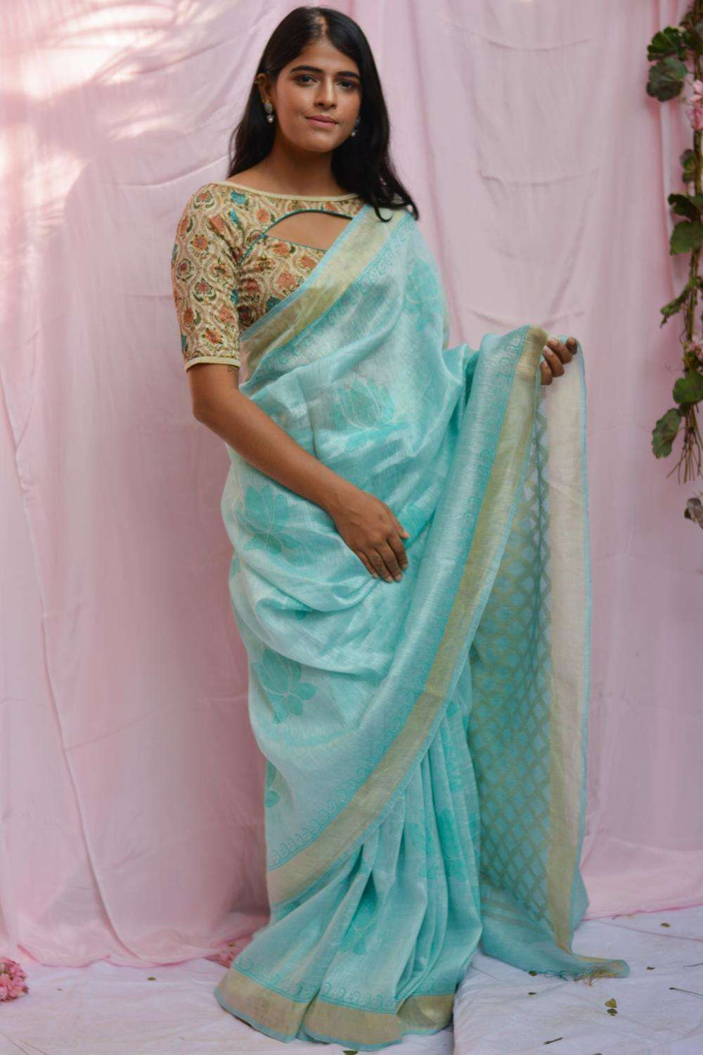 Powder blue linen silk saree with block print and Ikat pattern pallu