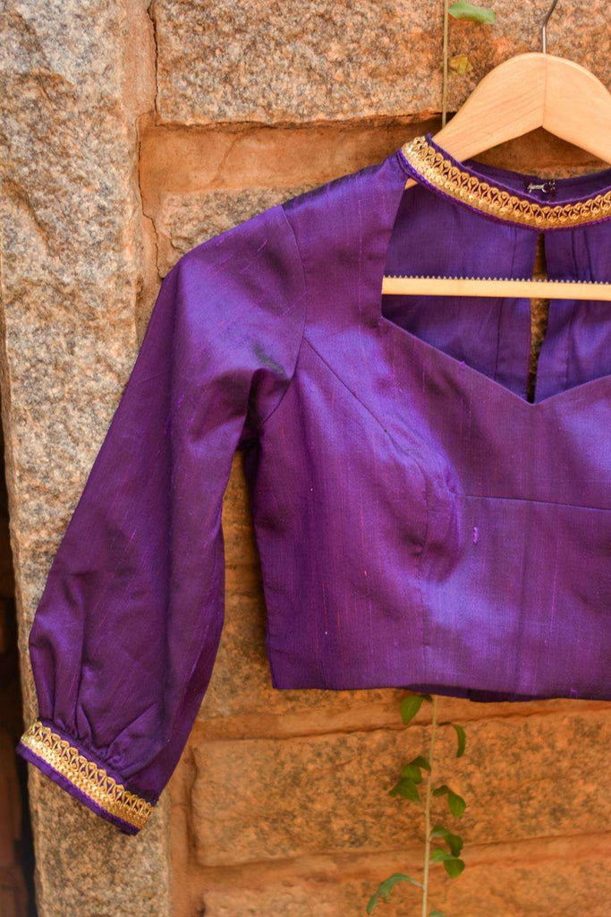 Purple raw silk hi neck blouse with puff sleeves and border detailing - House of Blouse