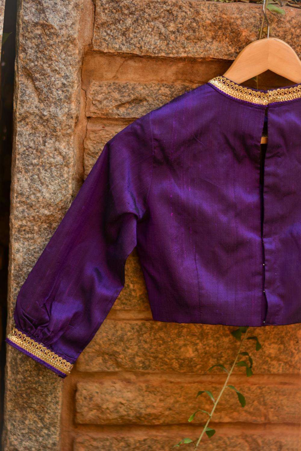 Purple raw silk hi neck blouse with puff sleeves and border detailing
