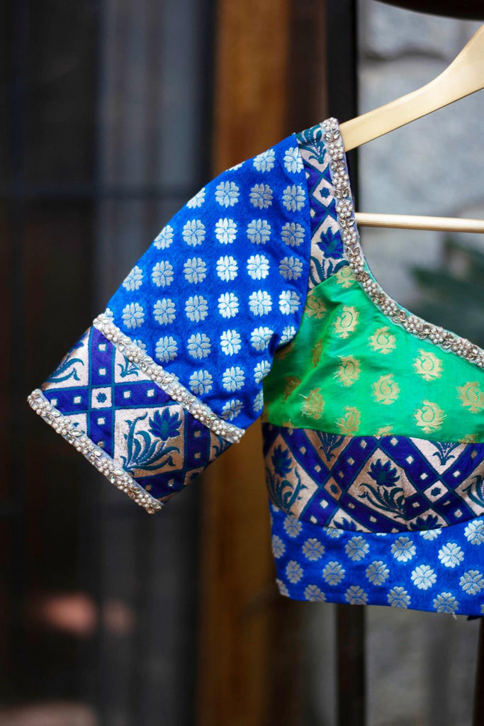 Patchwork blouse in blue and green brocade with kundan work border - House of Blouse