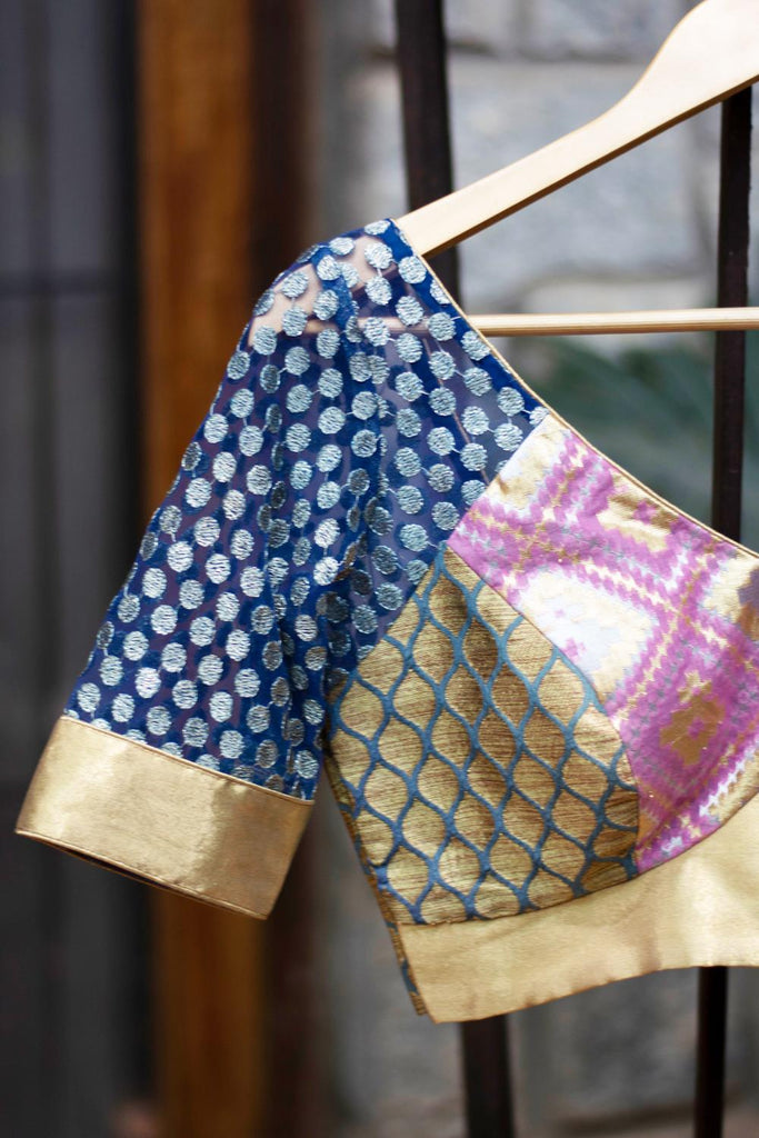 Patchwork blouse in pink and blue brocade with net sleeves.