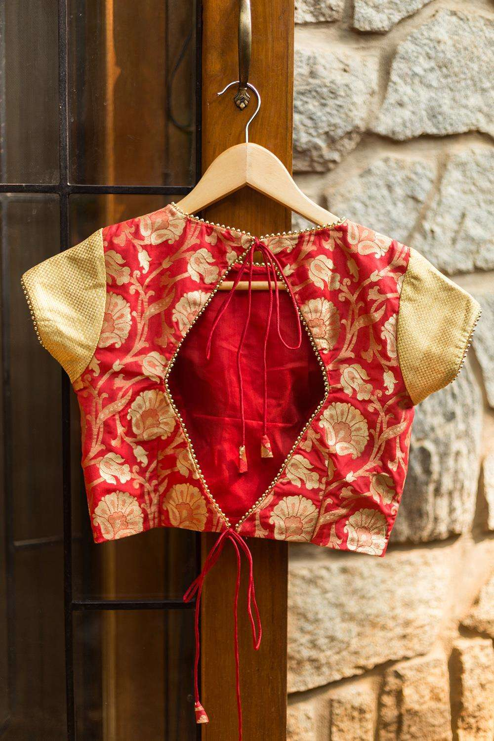 Red brocade closed neck blouse with gold brocade sleeves