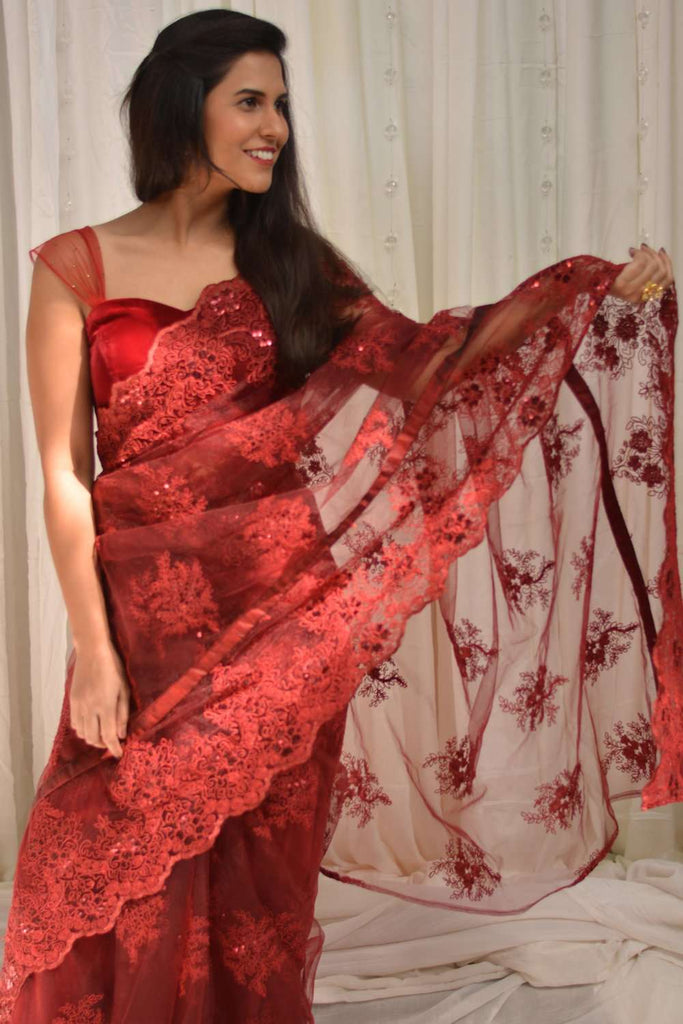 Red net saree with lacy self-coloured threadwork