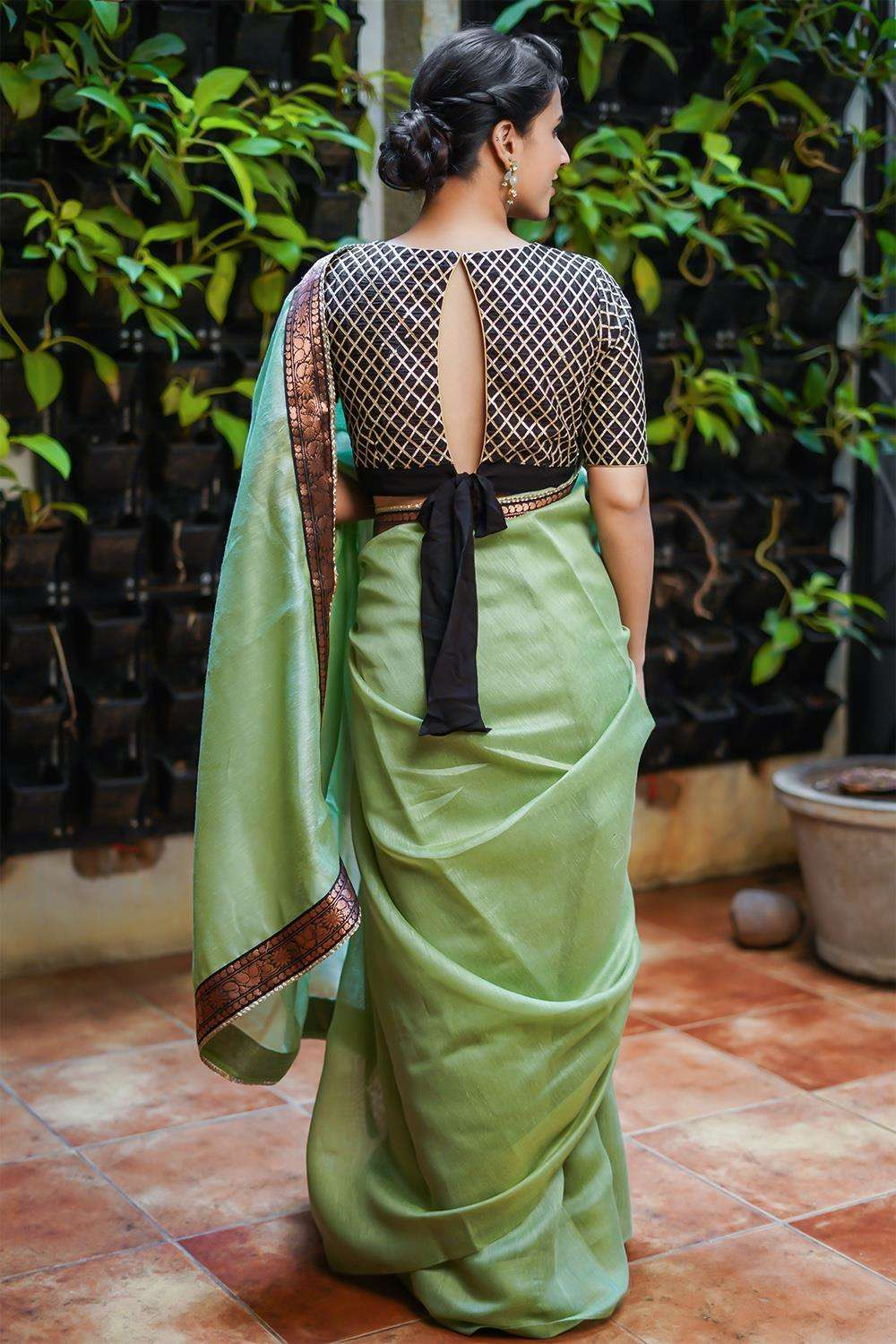 Sage green soft linen saree with black and copper brocade border and gold edging - House of Blouse