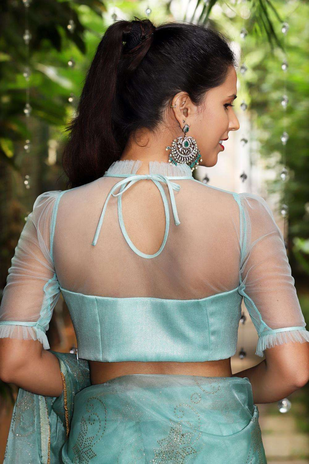 Sea green shimmer georgette and net sheer yoke blouse with frill detailing - House of Blouse