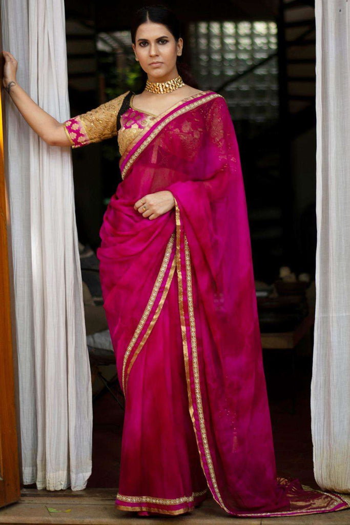 Shibori dyed pure chiffon saree in vivid pink, with border of zari, crystals, and gold beads