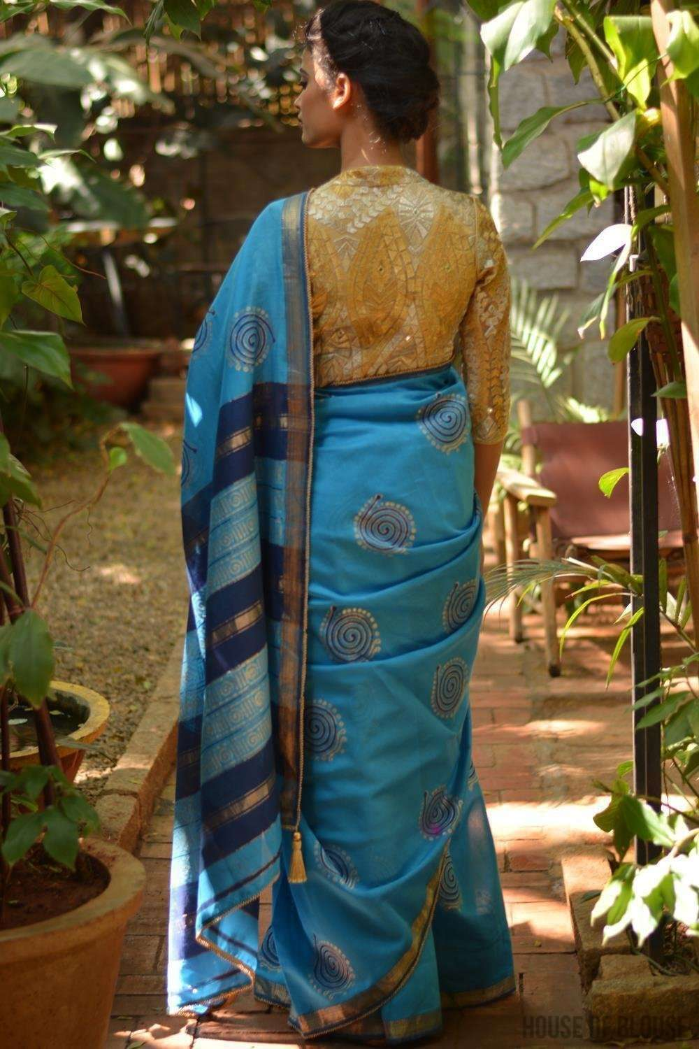 Sky blue Maheshwari handloom silkcot saree with blue and gold block print
