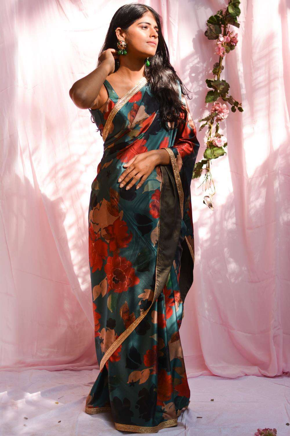 Teal floral printed pure satin saree with gold shimmer border