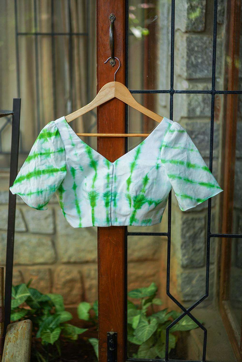 White and green shibori dyed cotton V neck blouse with bell sleeves
