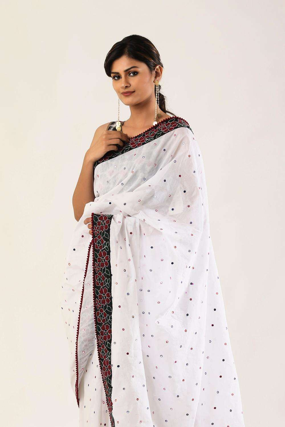White cotton saree with muticolour mirrorwork and threadwork floral border