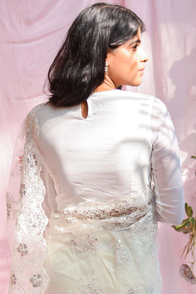 White crepe closed neck with chiffon full sleeves and pearl border