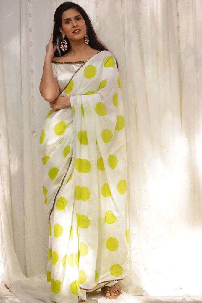 White crepe saree with lime green polka dots and gold frill border